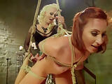 Redhead lesbian is anal fucked by blonde