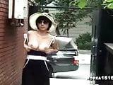 Sexy Korean MILF shows off in public