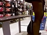 Spying girl in tights on shoes store