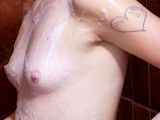 Catchy Teen caress herself with foam Shower 4K