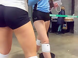 Volleyball players deliciously round ass in line