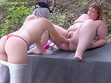 Deep fisting for a fat girlfriend. Lesbians with big asses have fun outdoors.