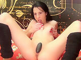 Brunette Myasxy sucks dildo