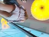 Upskirt shots on an escalator show two sexy chicks nice as