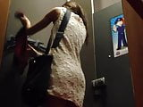 Asian girl in the dressing room with hidden cam
