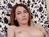 Slim redhead Elvira Nunah reveals hymen and masturbates