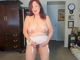 Sexy mature woman gets intense orgasm while dancing & strip tease