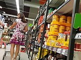 Very sexy mature lady in a store upskirt