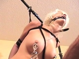 Real bondage action with a chap strapping this bitch taut