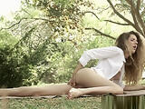 European model fingers her pussy outdoors