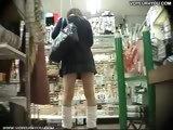 Mini-skirt girls crouching down