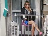 Teen girl sitting on an outdoor chair on the balcony