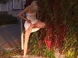 Blonde Babe Soaks Herself in Pee on Public Street