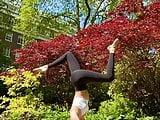 Noel Capri Berry doing yoga in black tights
