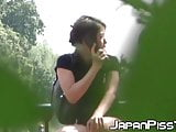 Sensual Japanese likes peeing while speaking on her phone