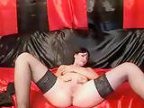 CharmingJuly in black stockings pulls her pussy