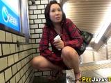 Japanese babe urinates in public