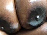 Ebony chick with perky nipples sucks big black cock