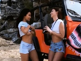 Busty Asian and brunette babe go to the sun in a Jeep
