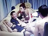 Two couples enjoying themselves in the living room