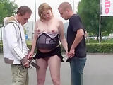 Chubby blonde girl fucks with two guys outdoor in car parking