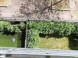 Voyeur spies on neighbour sunbathing nude