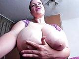 Brunette bounces her massive melons