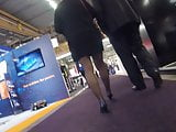 Candid mature in black pantyhose heels walking in expo