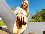 Girl ripping off her pants and dildoing outdoors