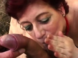 Outdoor picnic with a hot granny deep throating a big dick.